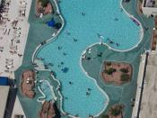 An above view of a roof-top swimming pool when looking down from the top of the Stratosphere in Las Vegas, NV.