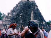 English: Maya priest performing a healing cermony at the ruins of Tikal, Guatemala. Attribute to: