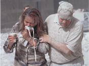 Man covered with ashes assisting a woman walking and holding a mask to her face, New York City