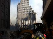 September 13, 2001: A New York City firefighter looks up at what remains of the South Tower.