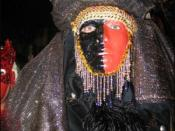 Exotic masquerader in beads, feathers, headdress, and face paint (2004)