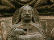 Depiction of the Trinity on the portal of the Basilica of St.-Denis, France (version losslessly cropped to remove inessential or distracting details for Trinity article). Shows the dove of the Holy Spirit above God the Father holding an Agnus Dei (symbol