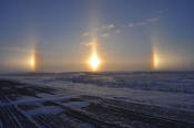 English: Sundogs on New Years Day 2011, near Carthage, South Dakota. Ambient temperature was near 0 degrees Fahrenheit.