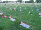 Flags that were placed on gravesites at Fort Logan National Cemetery during Memorial Day 2006