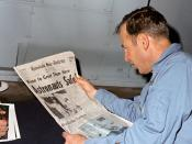 Apollo 13 commander, James A. Lovell, Jr., reads a newspaper account of the safe recovery of Apollo 13