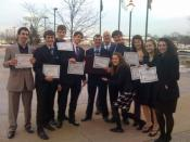 English: Members of the Benet Academy Law Club hold their award certificates after participating in a mock trial at the DuPage County Courthouse in Wheaton, Illinois.