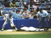 Rickey Henderson steals third base for the New York Yankees under the tag of Seattle Mariners Third baseman Jim Presley in the first game of a doubleheader at Yankee Stadium on August 19, 1988.