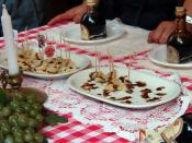 English: Balsamic vinegar drizzled over chunks of parmesan cheese, Modena, Italy.