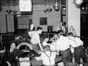 English: Globe and Mail newspaper staff wait for news of the D-Day invasion. Toronto, Canada.