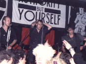 English: Crass at the Cleatormoor Civic Hall, UK, 3 may 1984. Photo by Trunt. Published under GFDL. Left to right: Pete Wright (bass), Steve Ignorant (vocals), N.A.Palmer (guitar). Uploaded by Rien Post (talk) 00:50, 6 March 2008 (UTC)