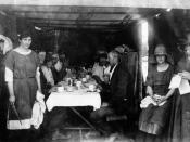English: Customers at the refreshment room after the fires in Chinchilla in 1922 An emergency shelter set up with tables, chairs, tablecloths and crockery to serve meals during the relief efforts after the fire. Women are wearing hats and a young woman to