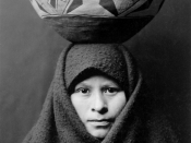 TITEL: Zuni girl with jar. Head-and-shoulders portrait of Zuni girl with pottery jar on her head.