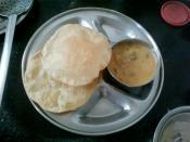 Poori and sagu is a popular indian food.