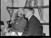 Count Felix Graf von Luckner smoking a pipe next to an unidentified man