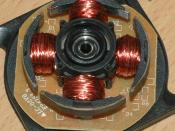 The four poles on the stator of a two-phase BLDC motor. This is part of a computer cooling fan; the rotor has been removed.