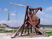 A trebuchet uses the gravitational potential energy of the counterweight to throw projectiles over long distances.