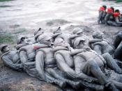 Image of BUD/S trainees covered in mud during Hell Week.