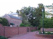 An older area of the University of South Carolina, with bricks of varying age and condition used in a building, several walls and as pavers. Image was taken at coordinates 33° 59' 51.4