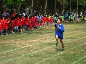 English: Students compete on the Northbridge International School fields for the local International Schools track meet.