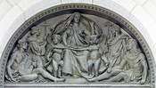 English: Exterior view. Bronze tympanum, by Olin L. Warner, representing Writing above main entrance doors. Library of Congress Thomas Jefferson Building, Washington, D.C. Cropped from the Library of Congress digital version using the GIMP.