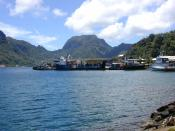 Portion of the dock area at Fagatogo, Pago Pago Harbor, American Samoa with Rainmaker Mt. (Pioa Mtn.) in the background. Photographed by Eric Guinther.