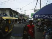 Busy street lined with shops and vendors in Tondo, Manila