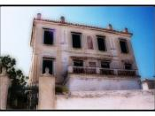 English: An abandoned house on the island of Spetses. John Fowles lived on Spetses for a while, which served as inspiration for the island Phraxos in his novel, The Magus.