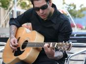 English: Picture I took of Mike Herrera of the band MxPx playing acoustic version of