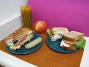 Two sandwiches; on the left a Subway club, on the right an Arby's chicken salad sandwich.