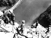 English: High scalers drilling into canyon wall 500 feet above the Colorado River in Black Canyon, site of Hoover Dam, 1932.