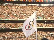 1996 Atlanta Olympics--Olympic flag at track and field venue. Olympic Stadium. Crowd scene.