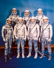 English: Project Mercury Astronauts, whose selection was announced on April 9, 1959, only six months after the National Aeronautics and Space Administration was formally established on October 1, 1958. They are: front row, left to right, Walter H. Schirra