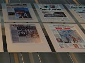 English: A panel in the Newseum in Washington, DC shows the September 12 headlines in America and around the world.