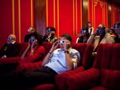 English: During a Super Bowl watching party in the White House theatre, the President and First Lady join their guests in watching one of the TV commercials in 3D. (Official White House photo by Pete Souza)