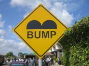 English: Speed bump sign at Philip S. W. Goldson International Airport in Belize City, Belize
