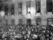Hitler at the window of the Chancellery on Wilhelmstrasse in Berlin while receiving the ovations of the people on the evening of the day.