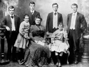English: Mooney family. Back row: James Mooney; Joseph Mooney; Francis Mooney and William Mooney. Front row: Rosa, Mrs Mooney? Mary seated on the settle with her mother. William Mooney became a bailliff in the Supreme Court of Brisbane.