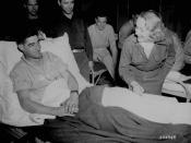 Dietrich signing a soldier's cast (Belgium, 1944).