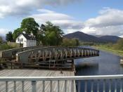 English: Banavie railway swing bridge - swinging Taken from the road bridge, which has itself just swung back after the passage of the yacht in the distance.