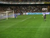 David Villa taking a penalty kick.