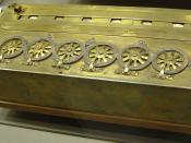 A Pascaline, an early calculator. (Machine à calculer de Blaise Pascal sans sous ni deniers, signed by Pascal 1642).