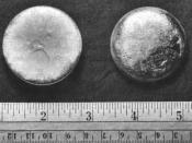 English: Plutonium Pictured against an inch and centimeter rule.