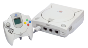 English: An NTSC Sega Dreamcast Console and PAL Controller with VMU.