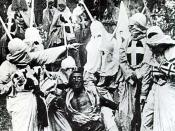 From The Birth of a Nation-Hooded Klansmen catch Gus, a black man portrayed in blackface by Walter Long