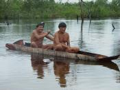 English: Two Kalapalo men canoeing in Brazil. Photo by Eduardo Giacomazzi.