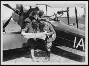 C.O. with pilot and observer referring  to photos and maps prior to setting out for the German lines