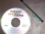 An image of a compact disc - Pencil included for scale