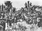 English: The ceremony for the driving of the golden spike at Promontory Summit, Utah on May 10, 1869; completion of the First Transcontinental Railroad. At center left, Samuel S. Montague, Central Pacific Railroad, shakes hands with Grenville M. Dodge, Un