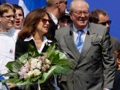 English: Jean-Marie Le Pen (on the right) and his wife (on the left) at his National Front party's annual tribute to Joan of Arc in Paris. Français : Jean-Marie Le Pen (à droite) et sa femme (à gauche) à la tribune lors du défilé du Front National en l'ho