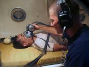 US Navy diver simulates oxygen treatment with an Armed Forces of the Philippines navy diver